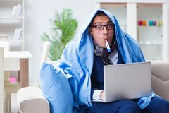 The sick businessman working from home due to flu sickness. Sick businessman working from home due to flu sickness Royalty Free Stock Image