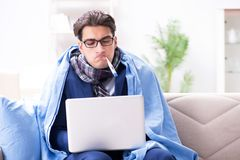The sick businessman working from home due to flu sickness. Sick businessman working from home due to flu sickness Royalty Free Stock Photos