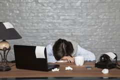 Sick businesswoman fell asleep on the desk with exhaustion. Portrait of a business person Royalty Free Stock Photography