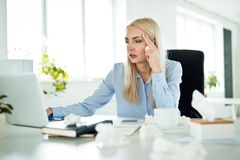 Sick businesswoman at work, feeling unwell stock photography