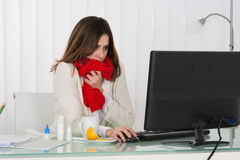 Sick Businesswoman Working In Office. Sick Young Businesswoman Working On Computer In Office stock photography