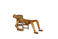 Sick in a chair. Hanging on the edge of the chair, suffering from an illness Royalty Free Stock Images