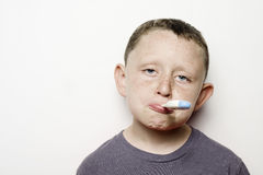 Sick Child. A sick child with a thermometer in his mouth Royalty Free Stock Photo