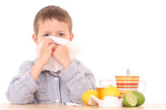 Sick child. 5-6 years old boy with thermometer and cold and flu remedy Stock Image