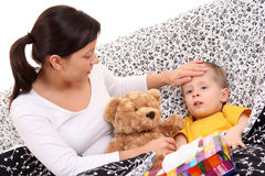 Sick child. 4 years old boy and his mother - flue season Royalty Free Stock Photo