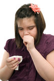 Sick Child. A young girl is sick and is coughing, isolated against a white background Stock Images