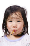 Sick Child. A young asian girl with a thermometer  not feeling very well Stock Photo