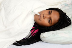 Sick child in bed Stock Images