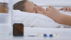 Sick Child in Bed, Ill Kid with Thermometer, Girl in Hospital, Pills Medicine stock photos