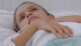 Sick child in bed, ill kid with thermometer, girl in hospital, pills medicine.  stock video footage