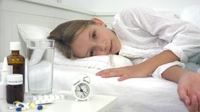 Sick child in bed, ill kid with thermometer, girl in hospital, pills medicine.  stock footage