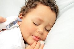 Sick child in bed. Image of Sick child in bed stock photo