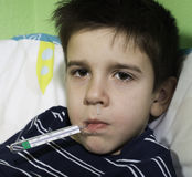 Sick child in bed. Royalty Free Stock Photos