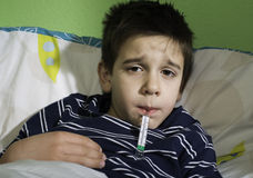 Sick child in bed. Royalty Free Stock Images