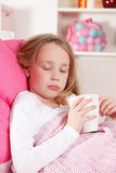 Sick child in the bed. Sick powerless child laying in the bed Royalty Free Stock Photography