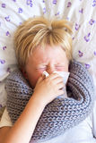 Sick child blowing nose Royalty Free Stock Images