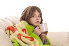 Sick child. Boy drinking tea Royalty Free Stock Photography