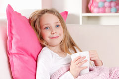 Sick child drinking tea Royalty Free Stock Image