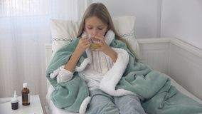 Sick Child Drinking Tea, Ill Kid in Bed, Suffering Girl, Patient in Hospital.  royalty free stock image
