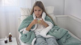 Sick Child Drinking Tea, Ill Kid in Bed, Suffering Girl, Patient in Hospital.  royalty free stock photo