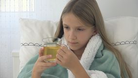 Sick Child Drinking Tea, Ill Kid in Bed, Suffering Girl, Patient in Hospital.  stock images