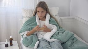 Sick Child Drinking Tea, Ill Kid in Bed, Suffering Girl, Patient in Hospital.  royalty free stock photography