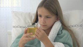 Sick Child Drinking Tea, Ill Kid in Bed, Suffering Girl, Patient in Hospital.  stock photo