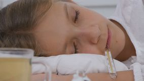 Sick Child Drinking Tea, Ill Kid in Bed, Suffering Girl, Patient in Hospital.  royalty free stock images