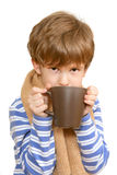 The sick child drinks tea Royalty Free Stock Photos