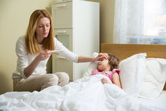 Sick child with fever royalty free stock image