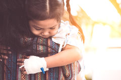 Sick child girl hugging and resting on her mother& x27;s shoulder. In the hospital Royalty Free Stock Photo