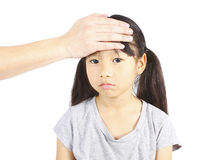 Sick child with hand on forehead Stock Photos