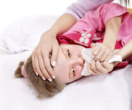 Sick child with handkerchief in bed. Royalty Free Stock Images
