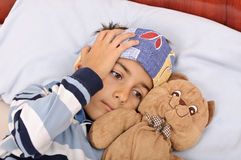 Sick child headache Stock Image