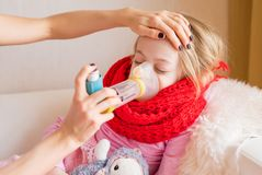 Sick child with inhaler. Sitting in bed Stock Photos