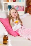 Sick child licking lemon Royalty Free Stock Images