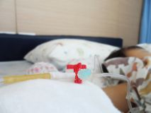 Sick child lying in a hospital with IV royalty free stock photography