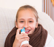 Sick child with nasal spray Stock Photos