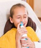 Sick child with nasal spray Stock Photos