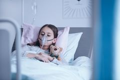 Sick child with oxygen mask royalty free stock photo
