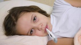 Sick Child Portrait with Thermometer, Ill Girl in Bed, Sad Kid Suffering Cold stock footage