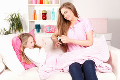 Sick child refusing to take medicine Stock Images