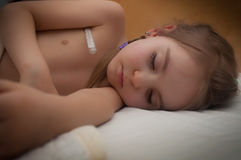 Sick child sleeps Stock Images