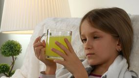 Sick child, suffering ill girl drinking effervescent vitamins, sad children 4K.  stock video footage