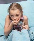 Sick child take medicine. Royalty Free Stock Photo