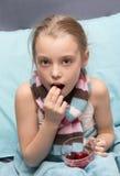 Sick child take medicine. Royalty Free Stock Photos