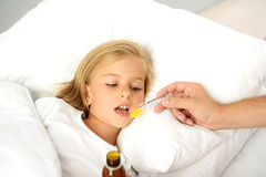 Sick child taking medicine Stock Photo