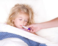 Sick childl with a thermometer in mouth Royalty Free Stock Photography