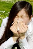 Sick chinese woman sneezing because of allergy Royalty Free Stock Photos