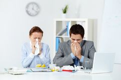 Sick co-workers Royalty Free Stock Photo